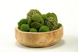 Assorted moss balls in round wooden bowl