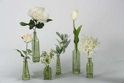 SET OF SIX GREEN GLASS BOTTLE WITH WHITE TULIPS, PEONIES, ALLIUMS AND ROSES