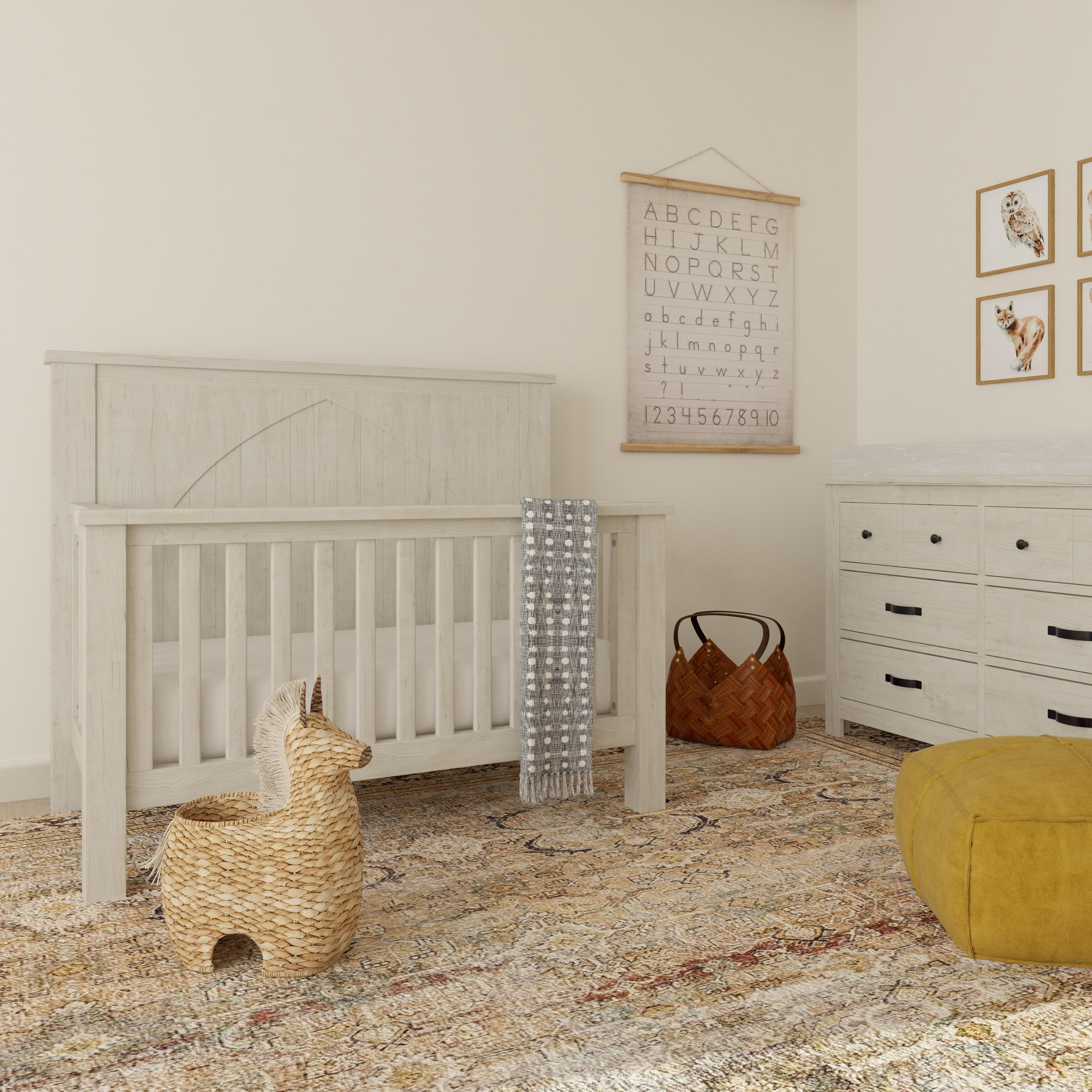 Charming Nursery With Earthy Pops